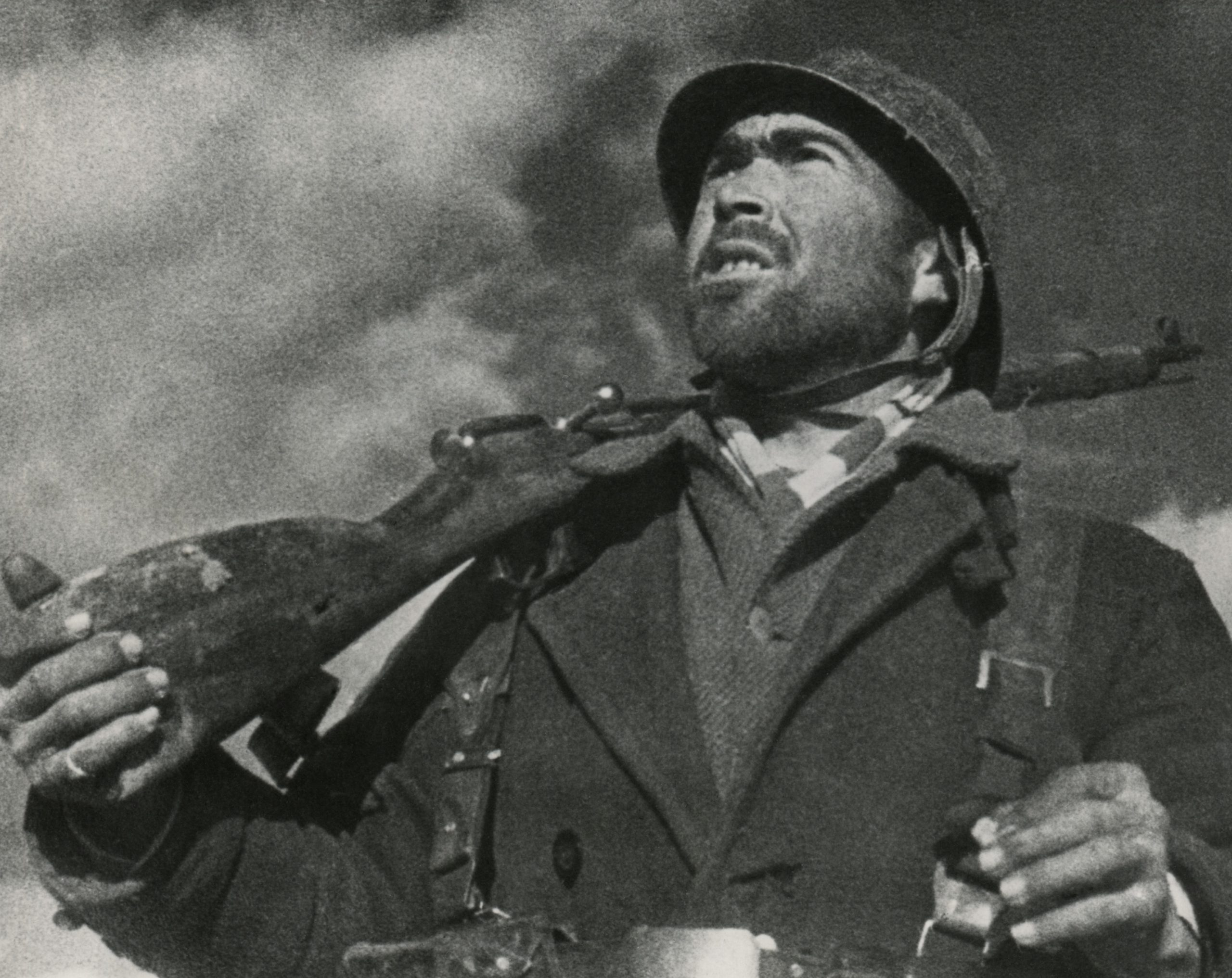 A soldier of the Spanish Republican (loyalist) army holds his rifle and looks out for aeroplanes on the Guadalajara Front. April 1937