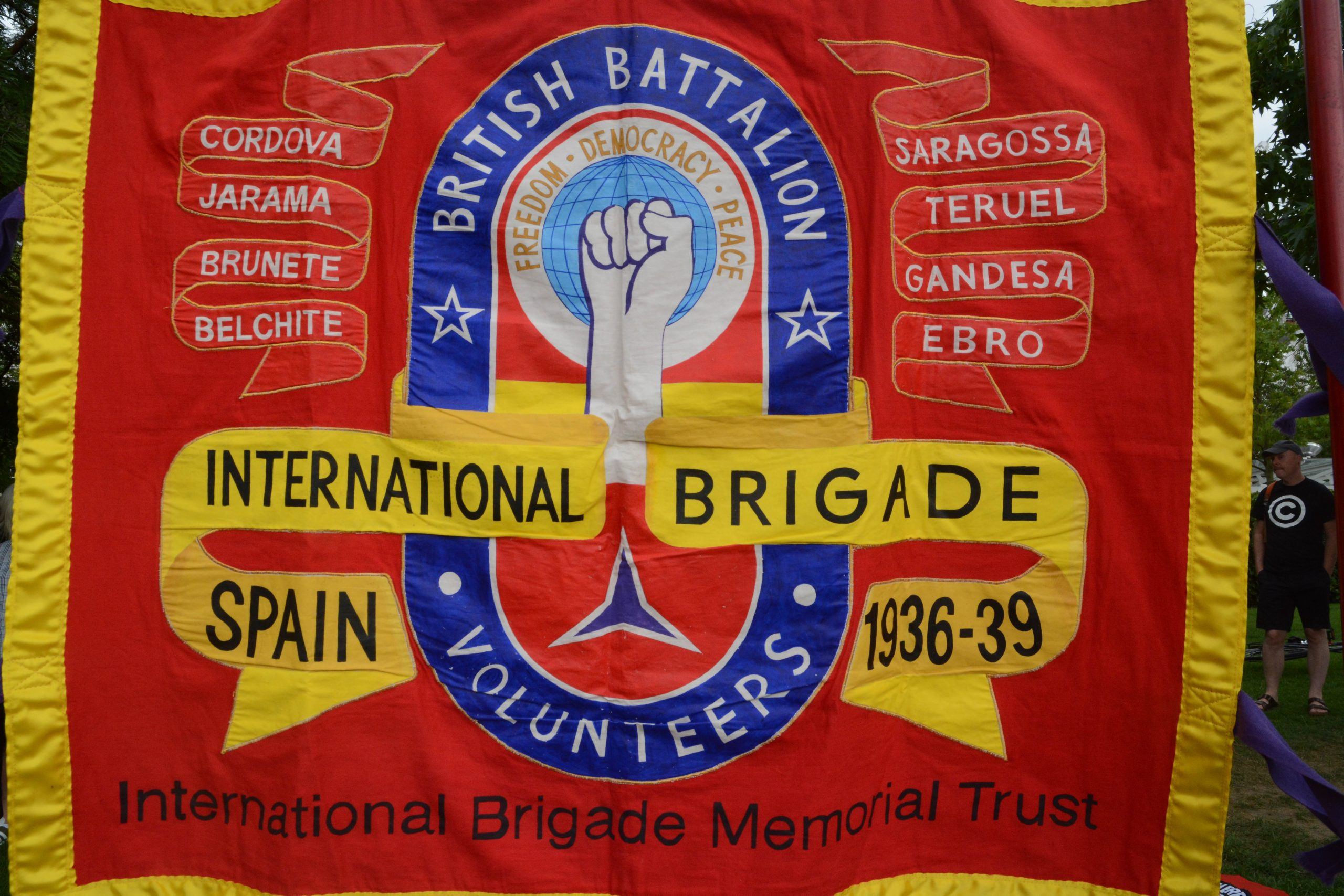 Photograph of the red, blue and yellow International Brigade Memorial Trust flag